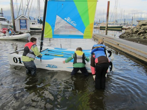 Getting right in the water to set sail is cold work!