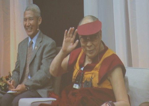 The Dalai Lama, sitting with his interpreter.