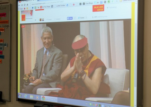 The Dalai Lama acknowledging the participants.